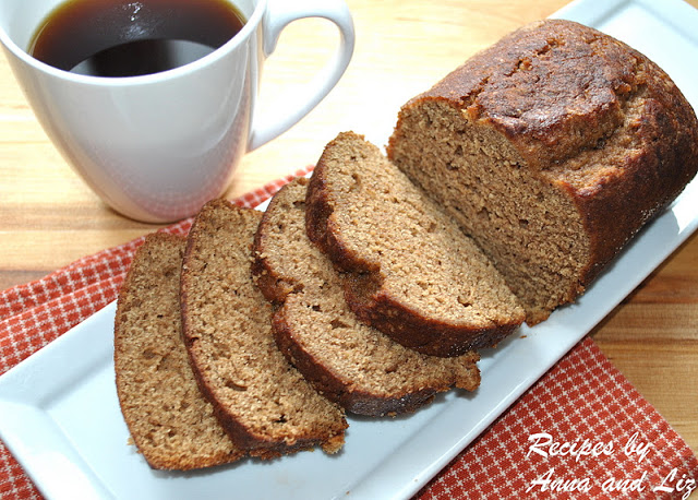 Sliced pumpkin bread is served with a cup of coffee. by 2sistersrecipes.com
