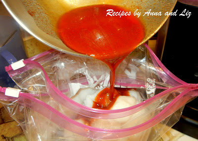 Marinade is being poured into the plastic bag with shrimp and scallops by 2sistersrecipes.com