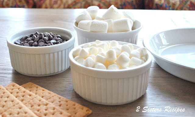 Photo of the 4 ingredients shown to make this s'mores dip. by 2sistersrecipes.com