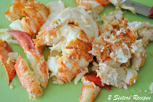 A photo of freshly cooked lobster chopped into pieces. by 2sistersrecipes.com