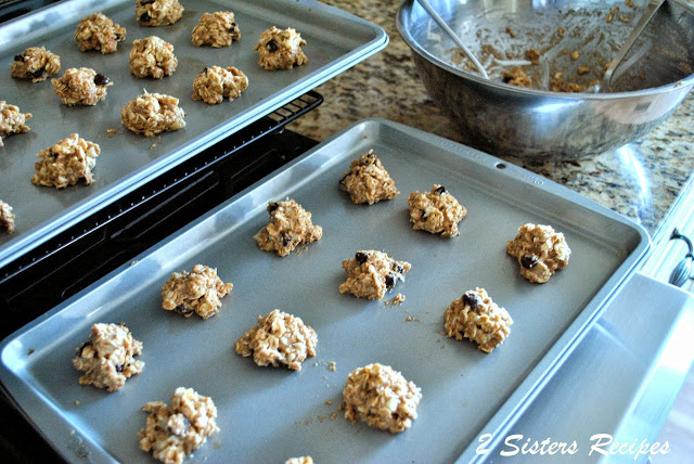 Cookie dough set on a baking sheet to bake. by 2sistersrecipes.com