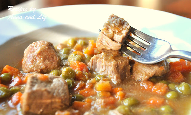 A forkful of the stew in a white dish. by 2sistersrecipes.com