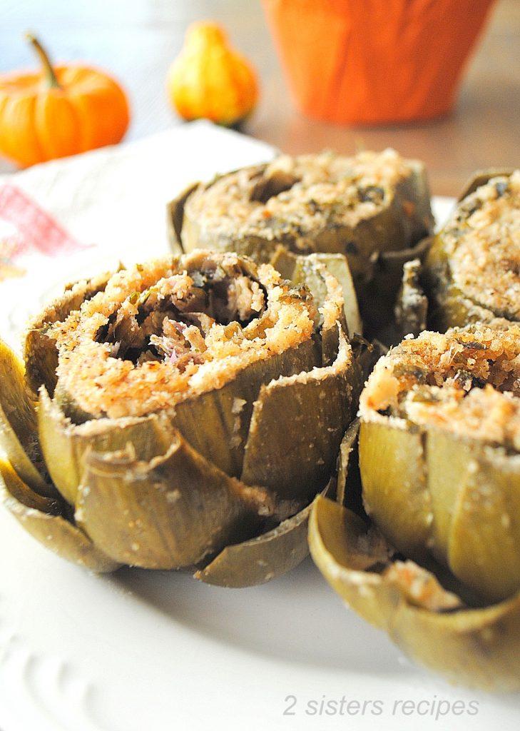 Garlic Stuffed Artichokes by 2sistersrecipes.com