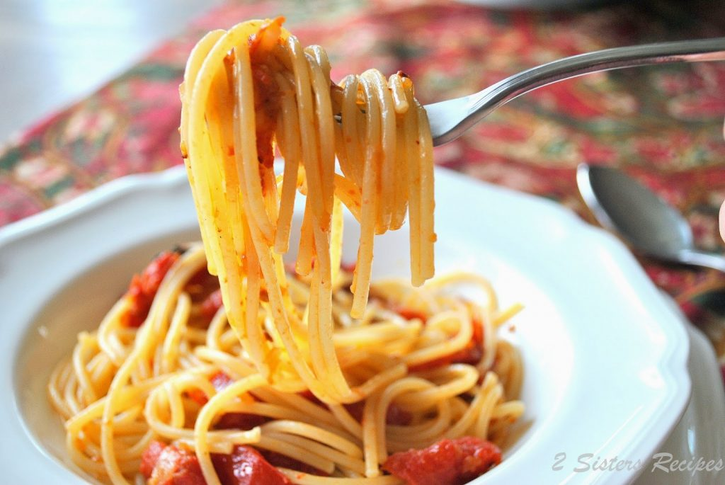 A forkful of Spaghetti with Oven-Roasted Tomatoes by 2sistersrecipes.com