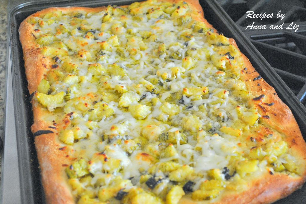 A full baking tray with an entire zucchini pizza. by 2sistersrecipes.com