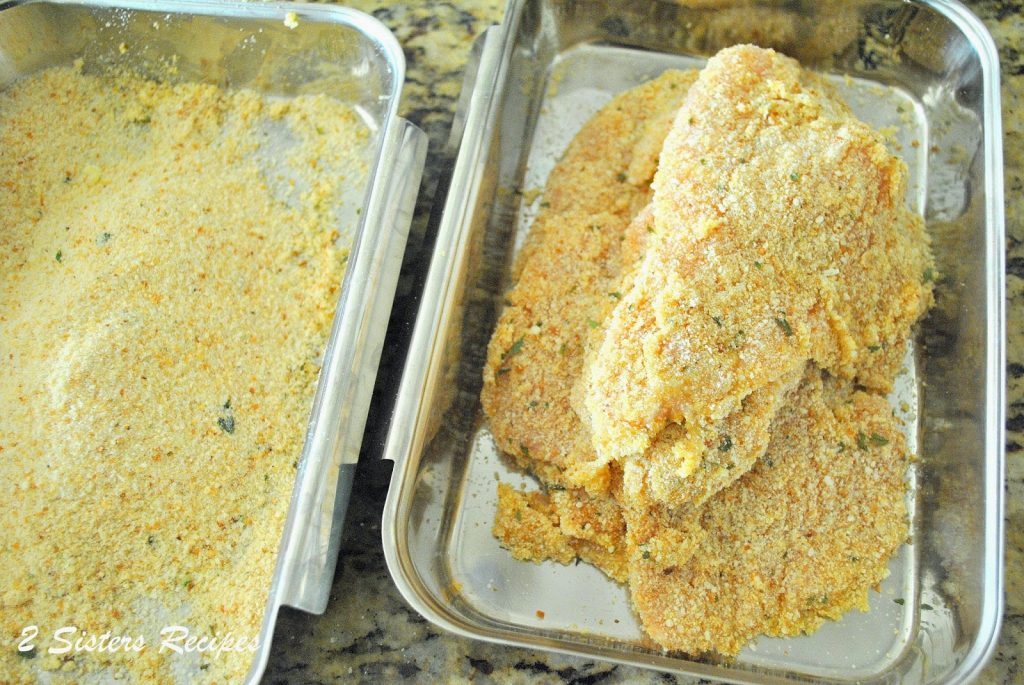 turkey cutlets breaded in bread crumb and cheese mixture 2sistersrecipes.com
