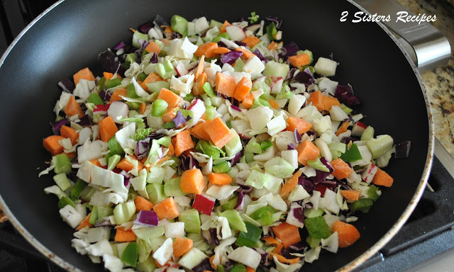 Mixed chopped vegetables in a large skillet. by 2sistersrecipes.com