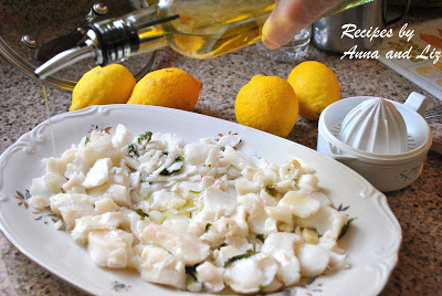 Olive oil is poured over the entire platter if cod fish. by 2sistersrecipes.com