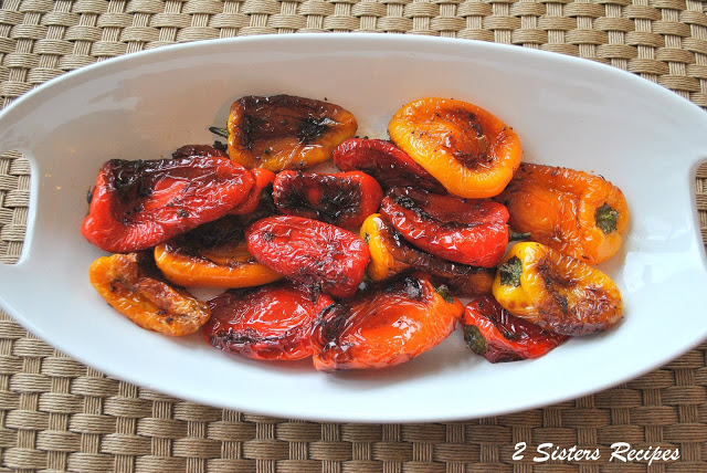 A white platter with cooked mini peppers. by 2sistersrecipes.com