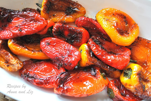 Close-up photo of sauteed peppers in a white serving platter. by 2sistersrecipes.com