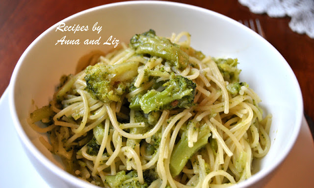 A bowl filled with spaghetti and broccoli by 2sistersrecipes.com
