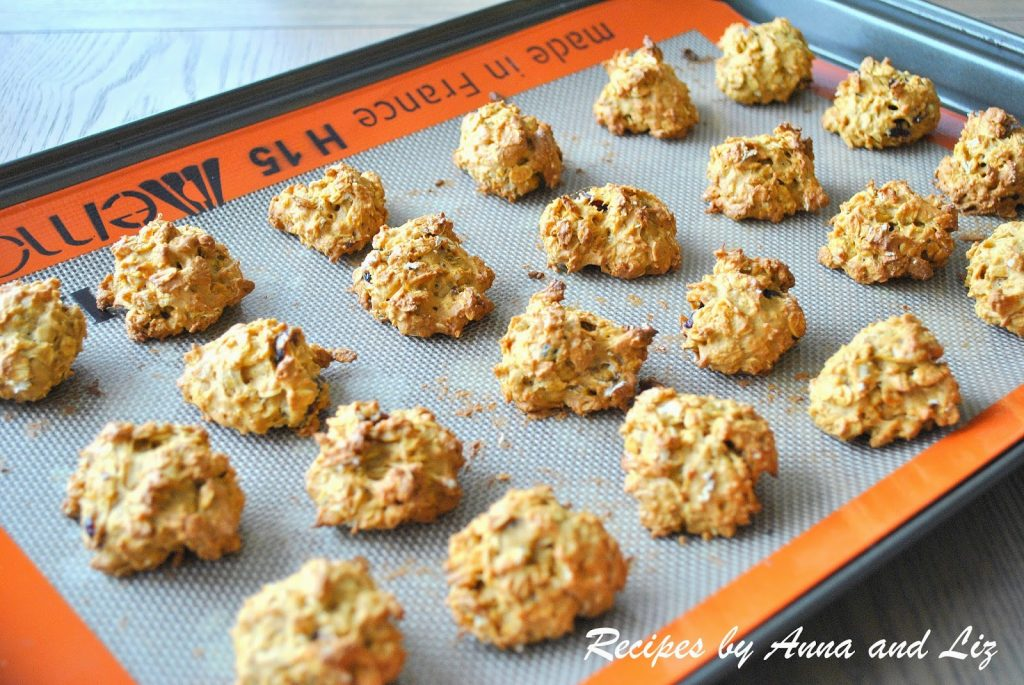 A baking tray loaded with baked pumpkin cookies. by 2sistersrecipes.com