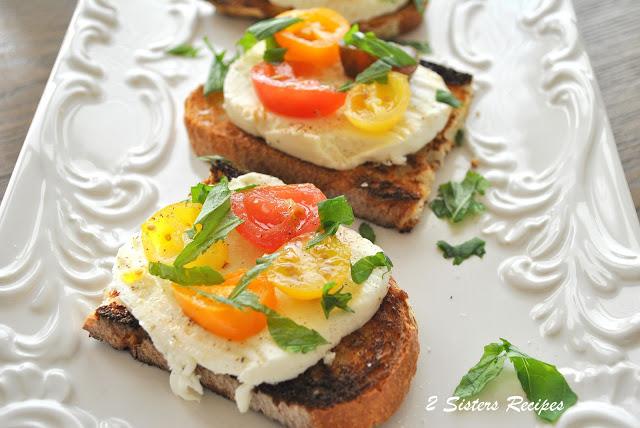 Burrata Caprese Crostini Bites by 2sistersrecipes.com