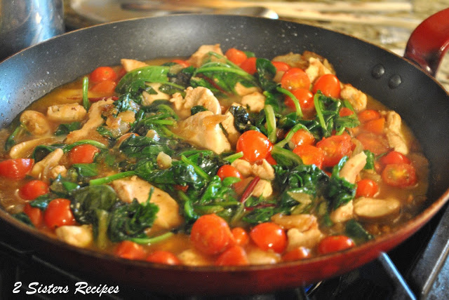 A skillet with all the ingredients simmering on the stove by 2sistersrecipes.com