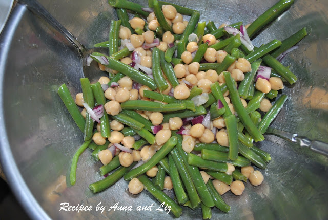 A silver mixing bowl with green beans and chickpeas. by 2sistersrecipes.com