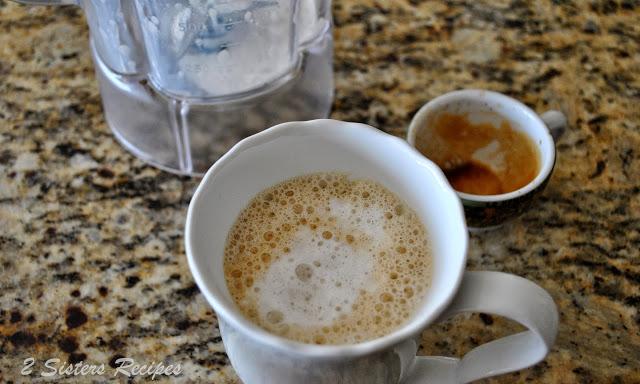 Espresso poured into a mug to make a latte. by 2sistersrecipes.com