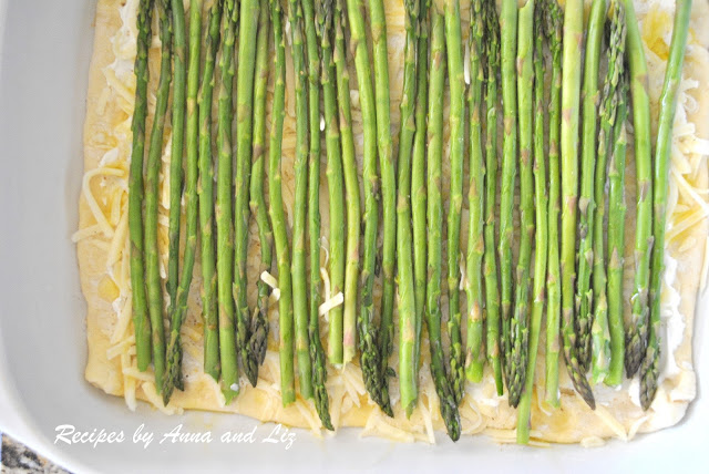 prepping the asparagus tart before baking. by 2sistersrecipes.com