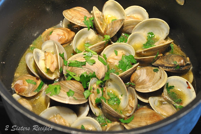 photo of clams steaming and cooking inside a pot. by 2sistersrecipes.com