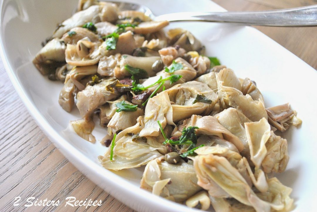 Artichoke Hearts Steamed with Olives, Capers and Garlic by 2sistersrecipes.com