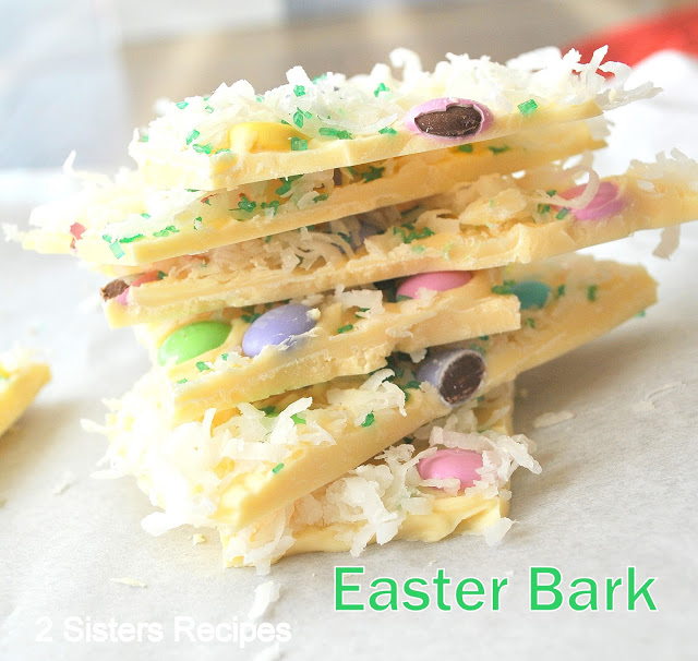 A pile of white chocolate bark cut into pieces. by 2sistersrecipes.com
