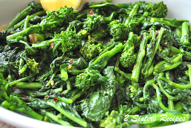 A platter with broccoli rabe cooked. by 2sistersrecipes.com