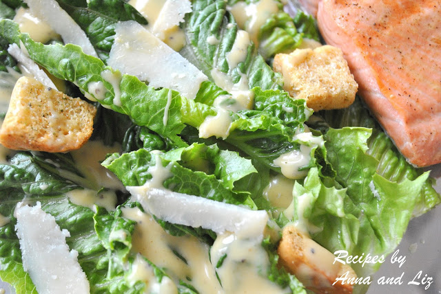 a photo of greens salad with grilled salmon. by 2sistersrecipes.com