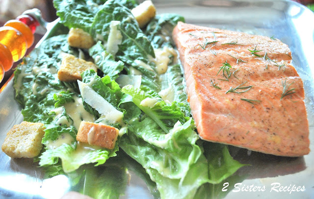 A platter of greens with grilled salmon. by 2sistersrecipes.com