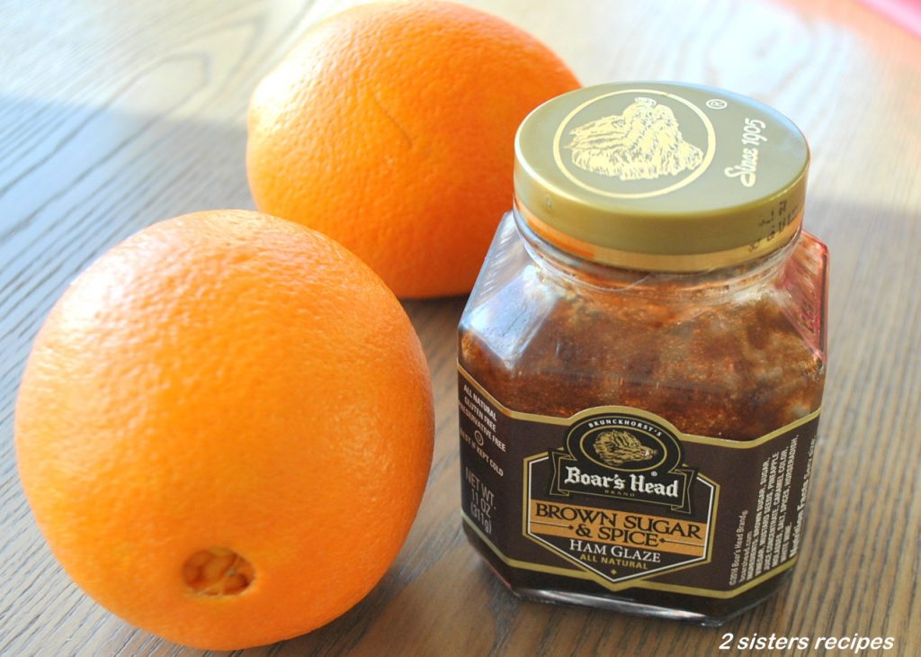 2 navel oranges and a jar of the brown sugar and spice glaze. by 2sistersrecipes.com