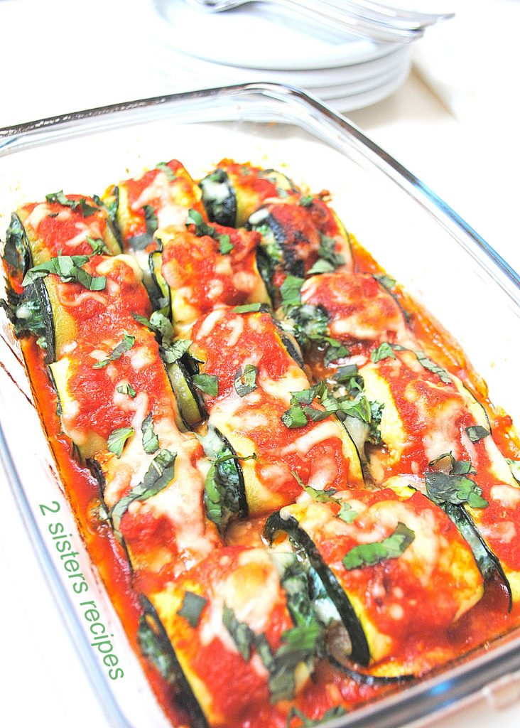 Healthy Vegetarian Recipes with a platter of our Zucchini Rollatini with Spinach and Cheese by 2sistersrecipes.com