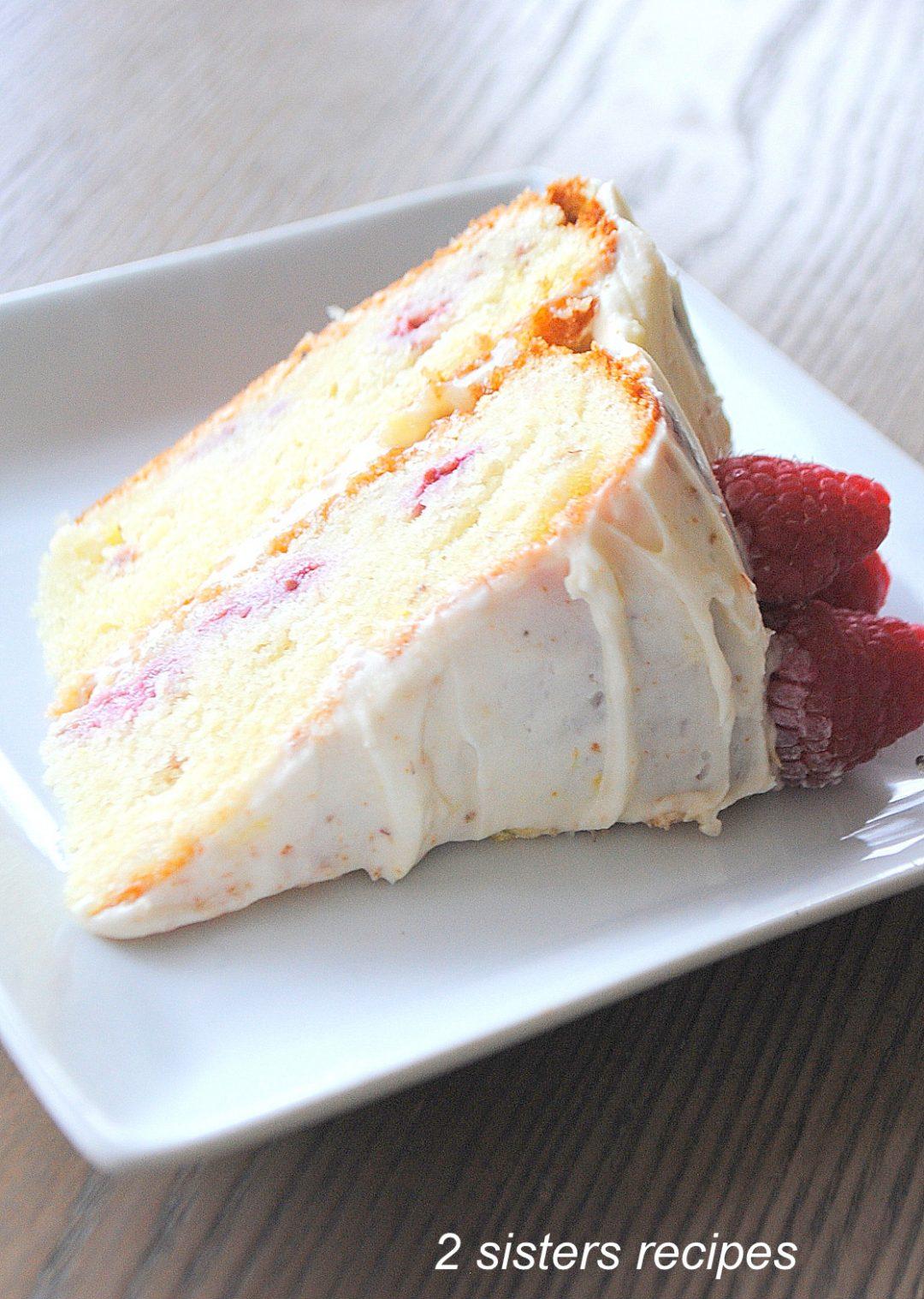 Bakery-Style Lemon Raspberry Cake by 2sistersrecipes.com