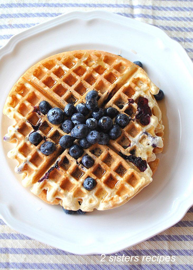 Light & Fluffy Lemon Blueberry Waffles by 2sistersrecipes.com