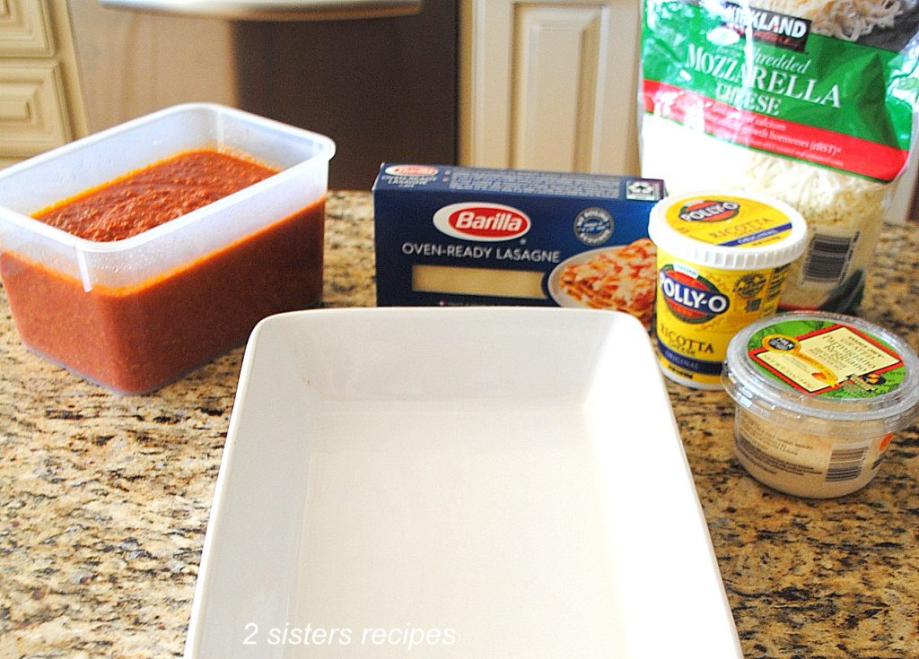 Photo of all the ingredients to make lasagna with No Boil Noodles by 2sistesrecipes.com