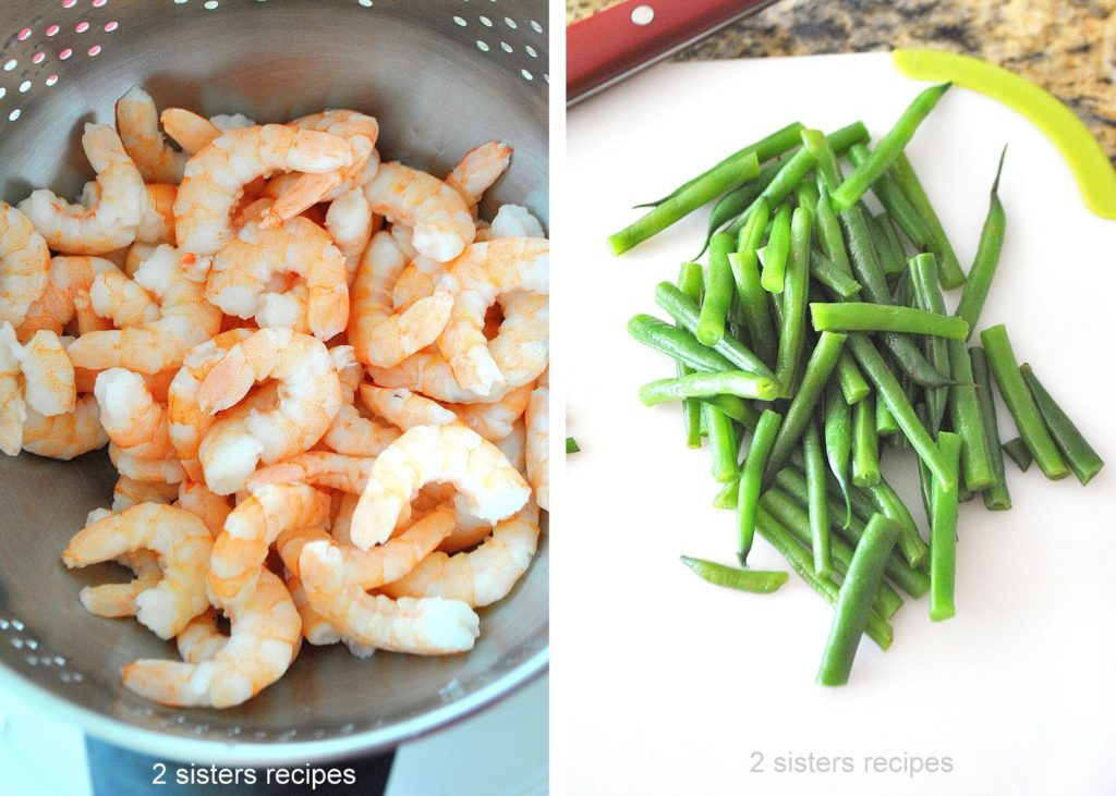 Shrimp in a colander, with green beans cut on a board. by 2sistersrecipes.com