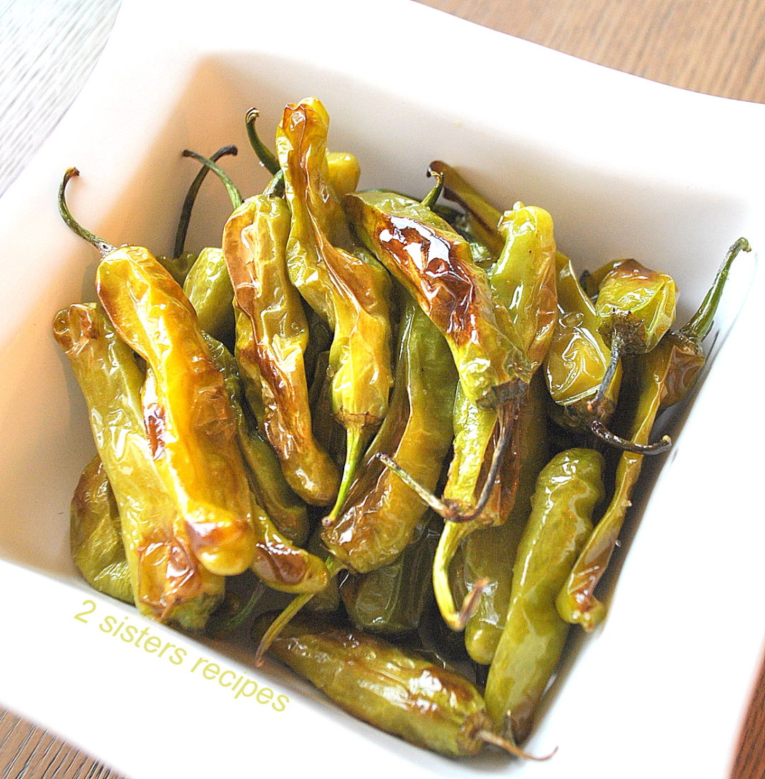 Easy Baked Shishito Peppers by 2sistersrecipes.com