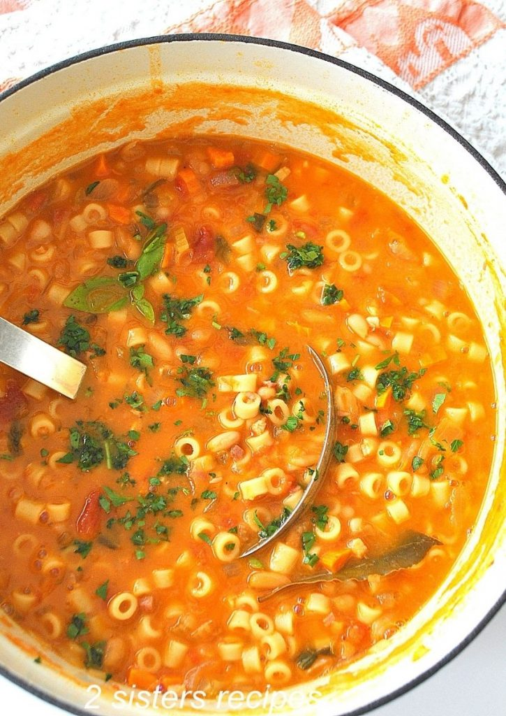 A big pot of soup with a ladle inside. by 2sistersecipes.com