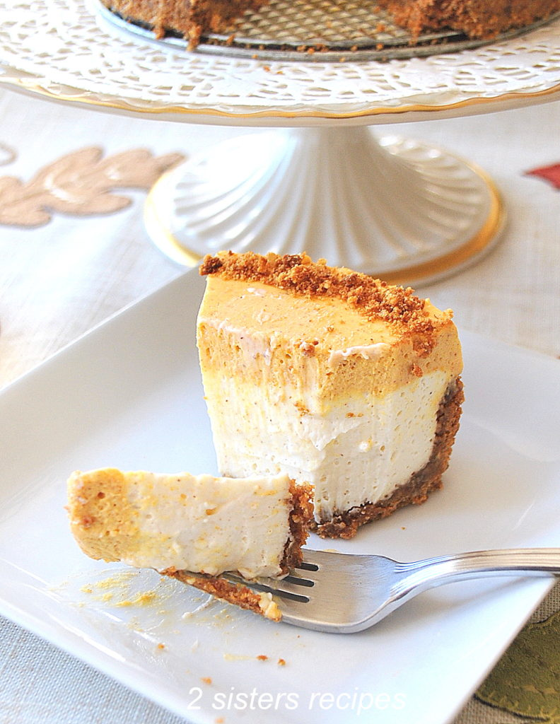 Photo of a forkful of the cheesecake on a serving plate by 2sistersrecipes.com