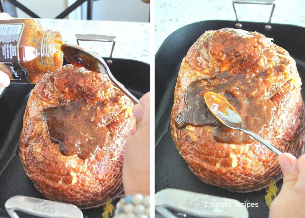 Glazing the spiral ham with a jar of glaze. by 2sistersrecipes.com