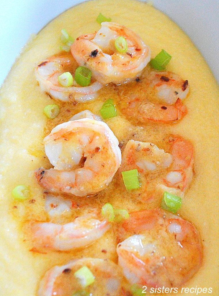 Close up photo of shrimp over creamy polenta by 2sistersrecipes.com