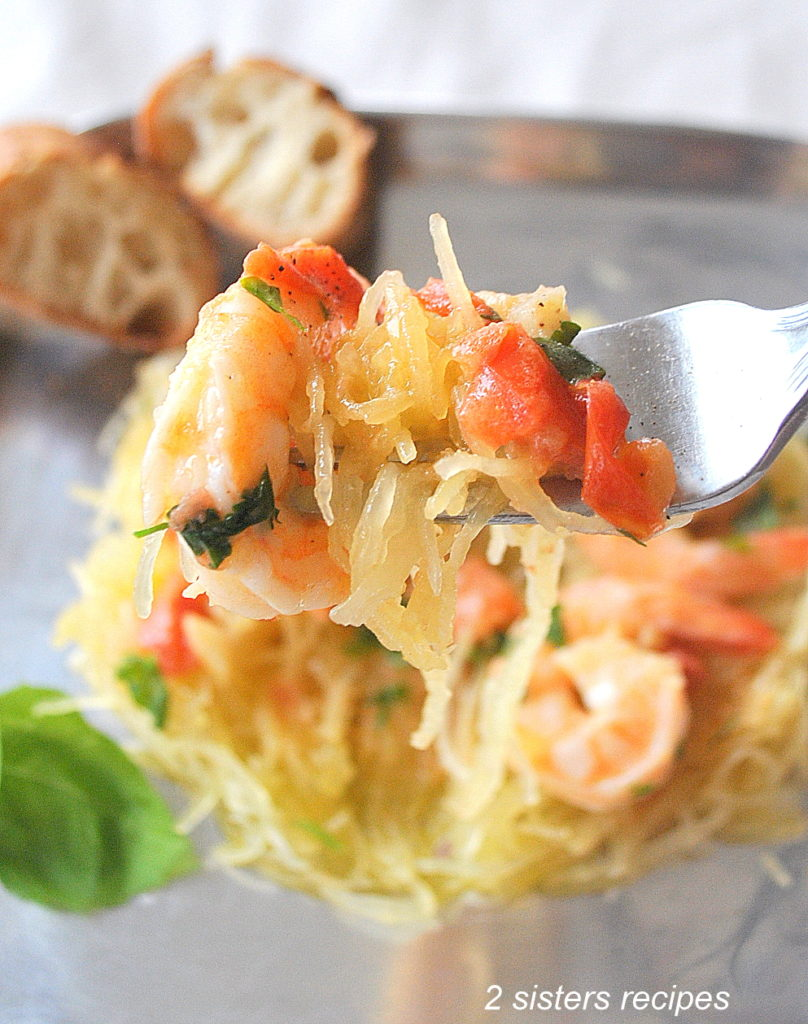 A forkful of Spaghetti Squash with Shrimp . by 2sistersrecipes.com