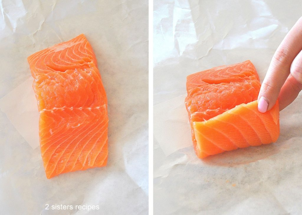 A photo of raw salmon sitting on white parchment paper. by 2sistersrecipes.com
