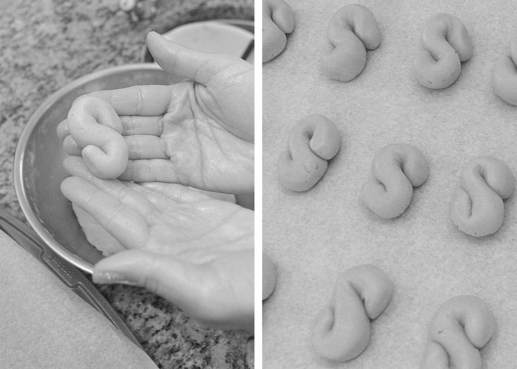 Sharping cookies into the letter S . by 2sistersrecipes.com