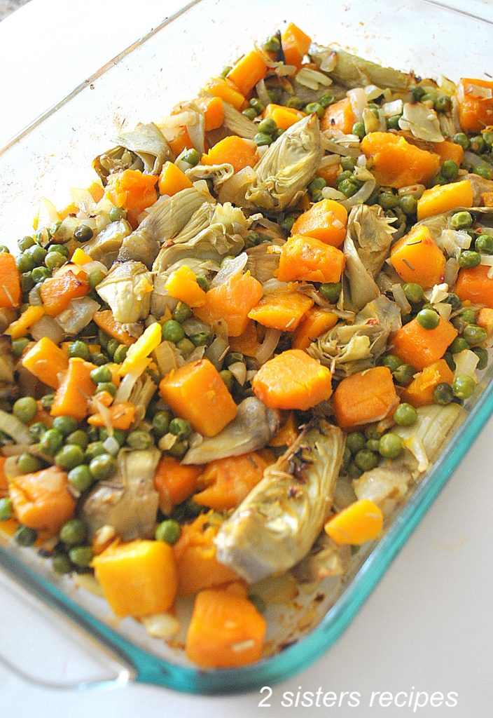 Photo of the mixture of veggies in a baking dish. by 2sistersrecipes.com