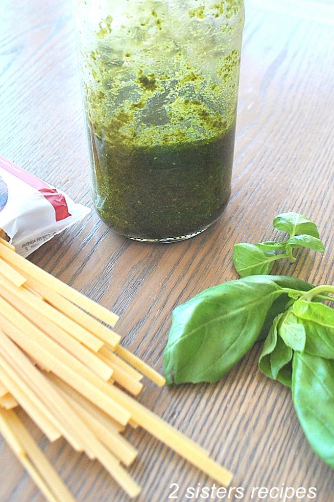 A jar filled with Spinach pesto sauce. by 2sistersrecipes.com