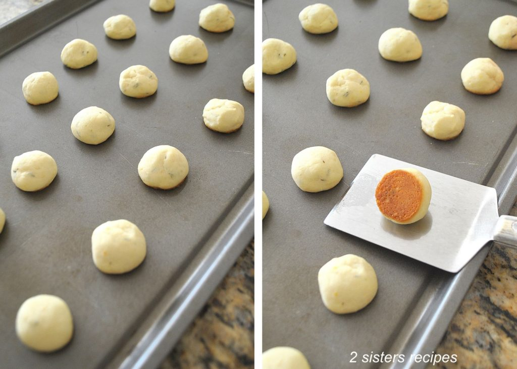 Photos of cookies fully baked on baking sheets. by 2sistersrecipes.com