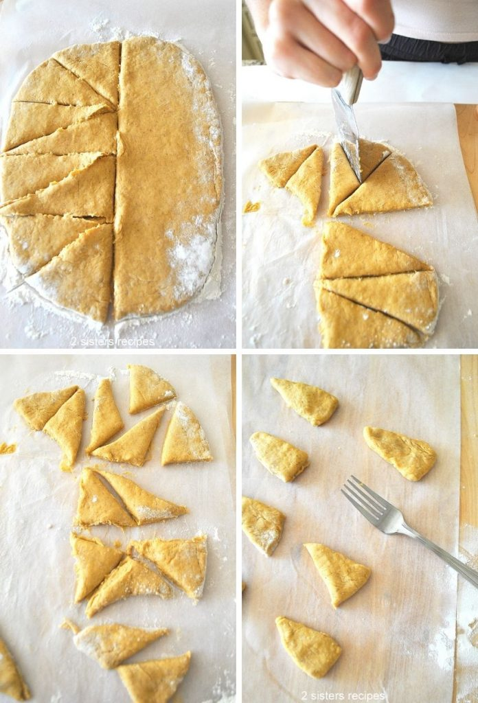Cutting the cough into triangles. by 2sistersrecipes.com