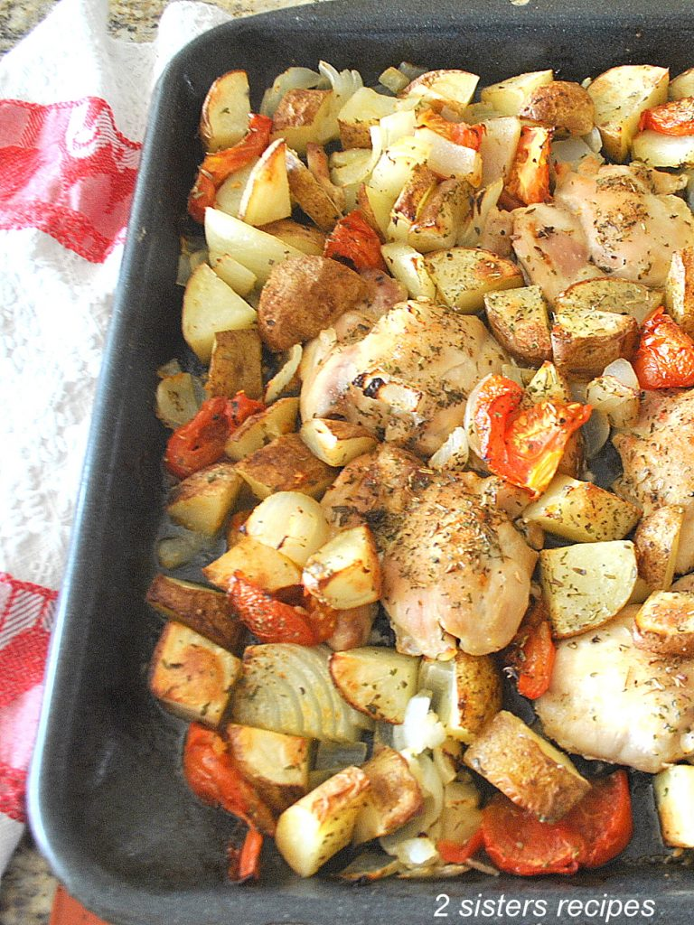 photo of sheet pan chicken and potatoes. by 2sistersrecipes.com