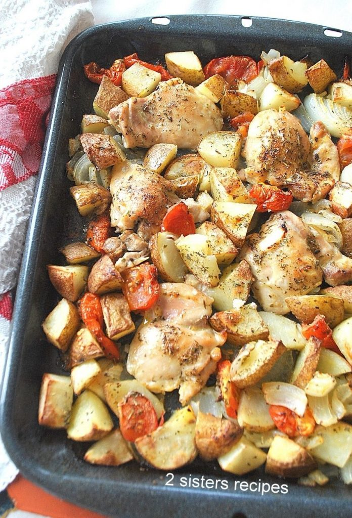Close up photo of the chicken and veggies baked. by 2sistersrecipes.com