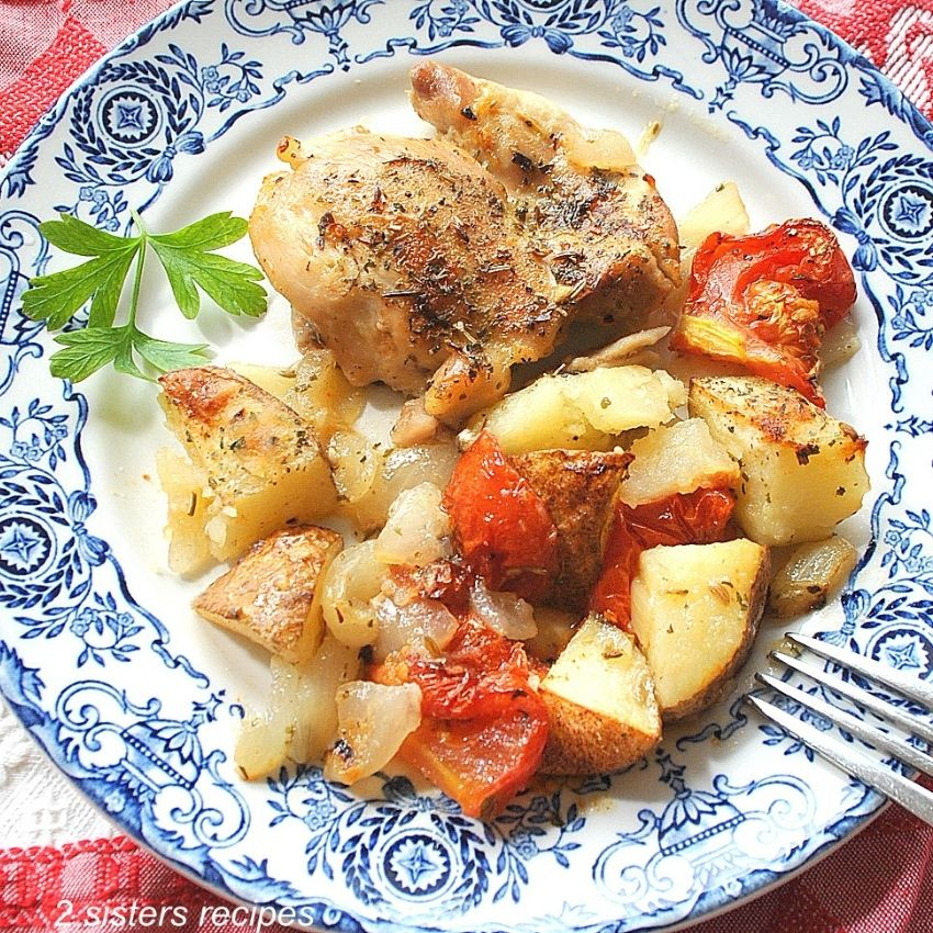 Roasted chicken and veggies on a blue and white plate. by 2sistersrecipes.com